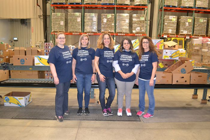 A group of volunteers is working at the Good Shepherd Food Bank in Auburn, Maine