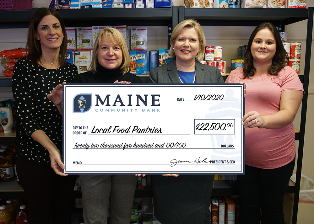 Maine Community Bank presents check to local food pantries